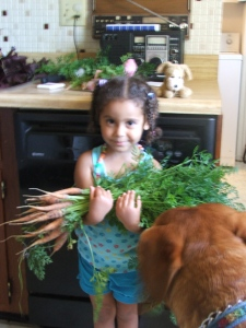 Dog, daughter and carrots.