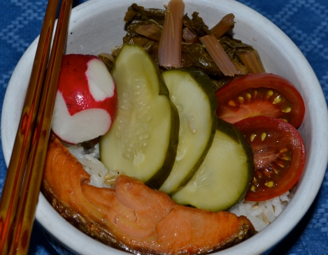 Grilled salmon plus cucumber pickles, pickled turnip greens, and pickled radishes. The tomatoes are Black Maori.